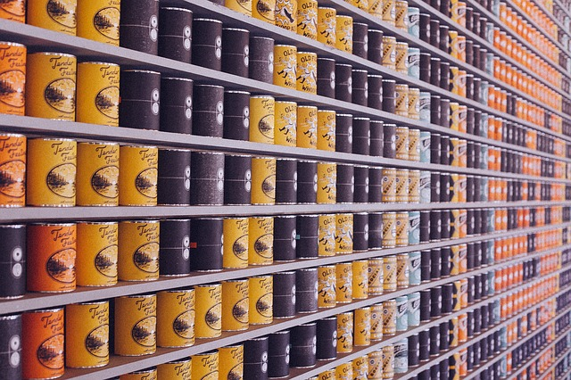 A shelf with cans – you might need to throw out some items in order to pack liquids and perishables when moving.