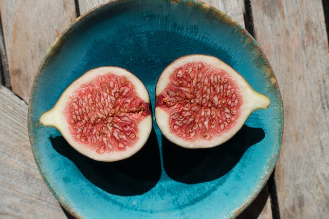 A pomegranate cut in half.