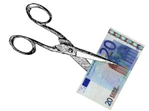 Scissors and money to cut your moving expenses.
