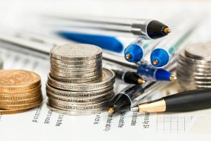 Pencils and money that you need to plan a moving budget