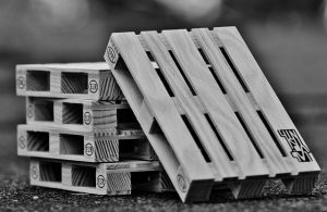 Black and white photo of two stacks of pallets.