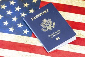 A passport and an American flag
