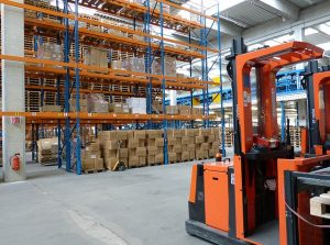 A forklift in a warehouse.