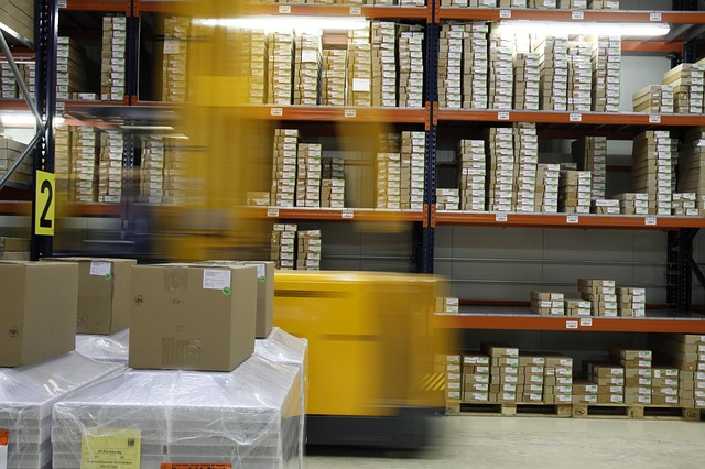 A warehouse with small packages on shelves.