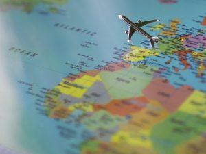 A figurine of a plane over a globe.