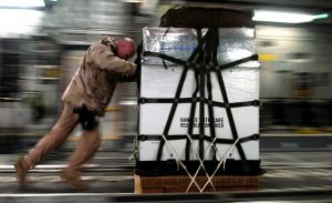 Worker pushing a cargo