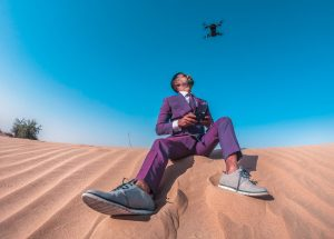 a man using a drone in desert