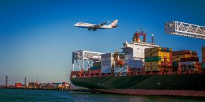container ship and an airplane