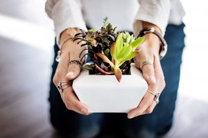a woman holding plants