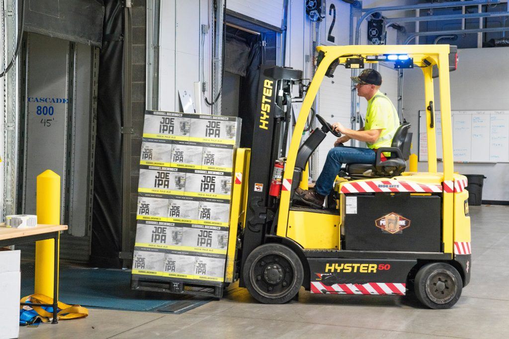 Man riding a yellow forklift