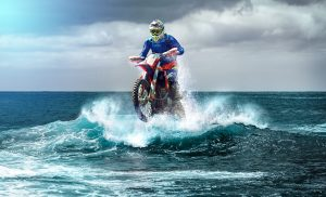 Motorcycle on the water that shows how transporting a motorcycle overseas is hard
