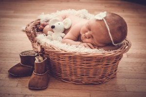Basket and a baby sleeping in it
