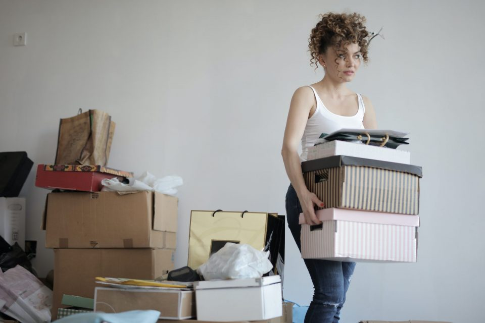 A woman happy to find affordable moving boxes