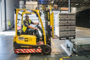 Man on a forklift assessing warehouse dos and don'ts