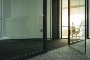 Black door frame and a grey carpet
