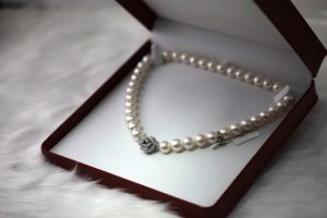 White pearl necklace in a box