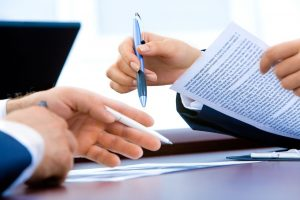 Picture of a contract. Get an accurate moving estimate before you sign the contract