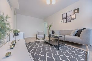 Grey living room where you'll pack and move large area rugs