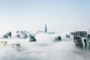 Buildings among clouds