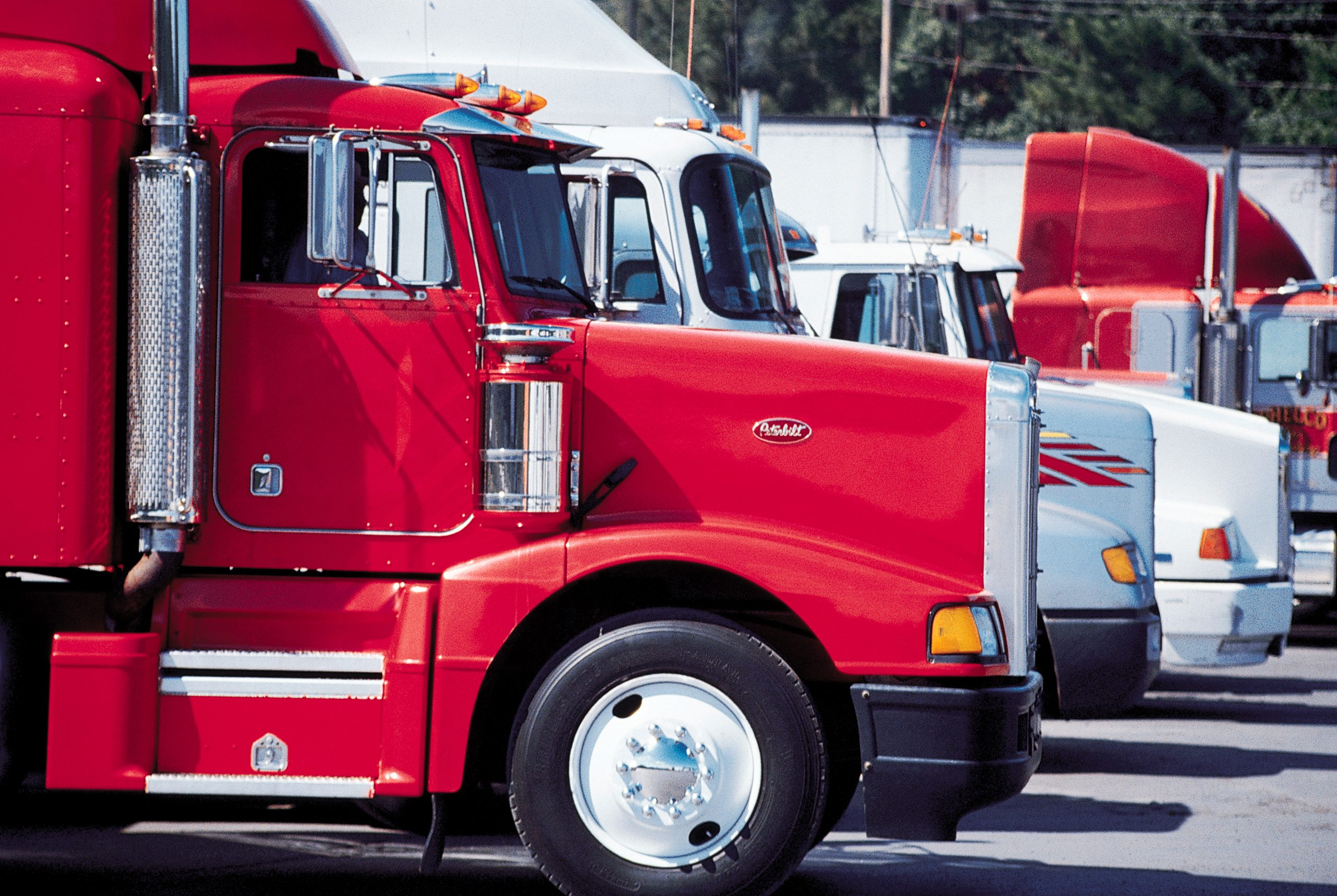 Picture of parked trucks. Shipping items to Dammam requires partners with quality vehicles