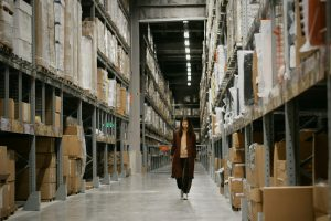 A woman wearing a mask to combat one of the downsides to warehousing