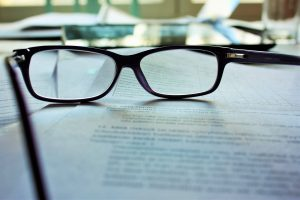 A document with glasses