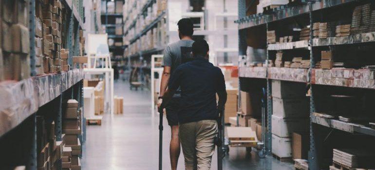 Men walking in a storage unit