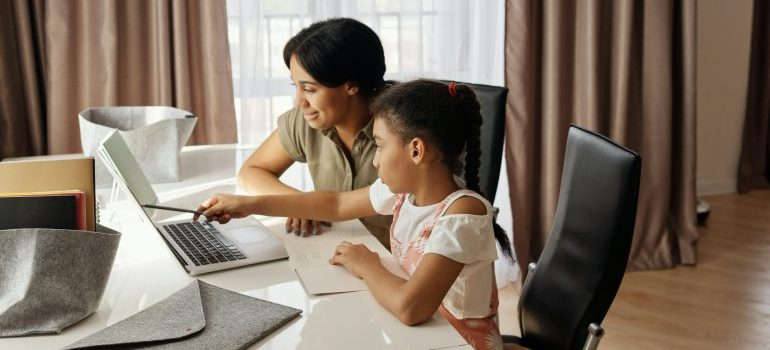Mother and daughter looking at the computer.