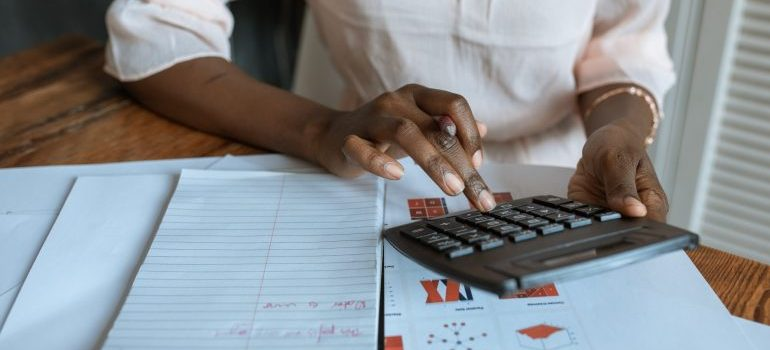Woman calculating costs