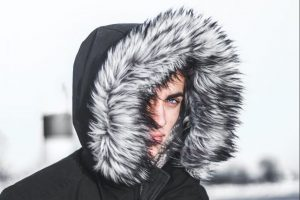 Person in winter jacket and hat