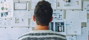 A man looks at the plan when arranging office space.