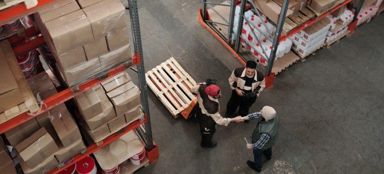 Man shaking hands with storage staff