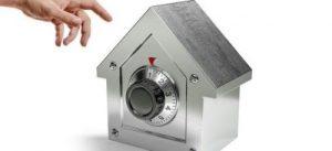 silver safe shaped like a house