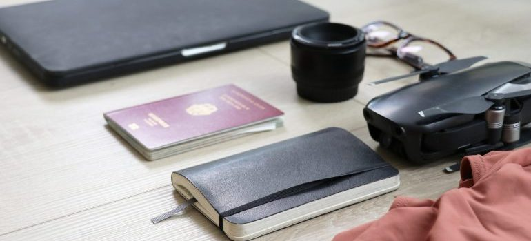 Laptop, planner and passport