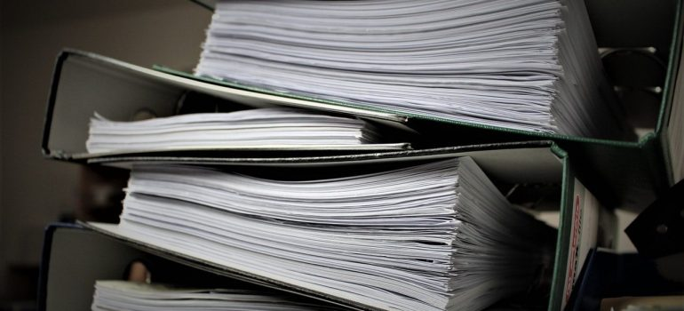 a stack of documents inside a file