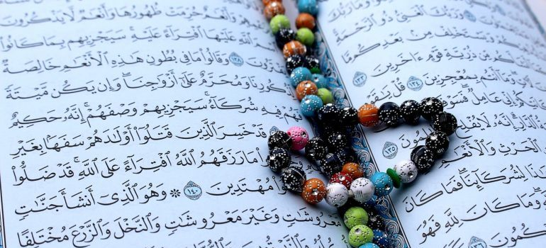 Pages in Arabic with a rosary