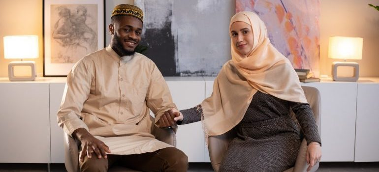 Man and woman wearing hijab who can help you understand and avoid expat problems when living in KSA