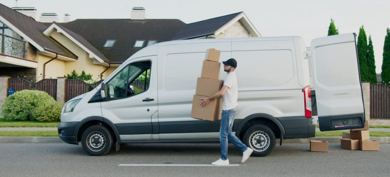 a delivery man carrying multiple boxes as one of the things to ask logistics agents before hiring them