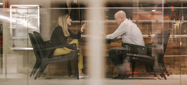 Two people meeting for business.