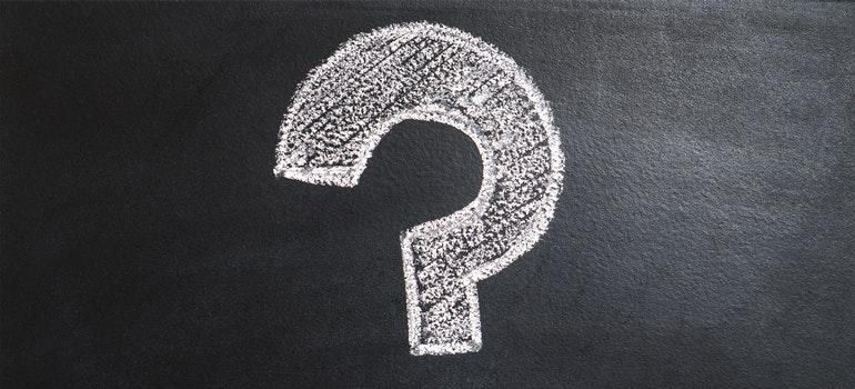White question mark on black wallpaper