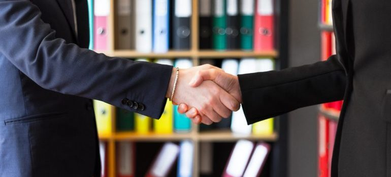 Two man shaking hands and sealing the business