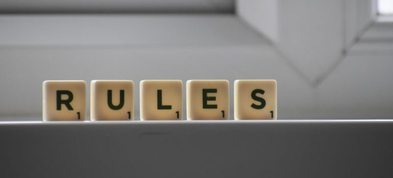 Rules written on small scrabble cubes