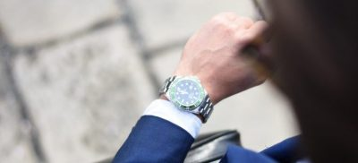 a businessman looking at his watch