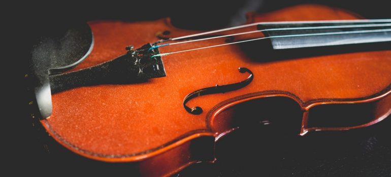 a dusty violin that will require packing when moving instruments overseas