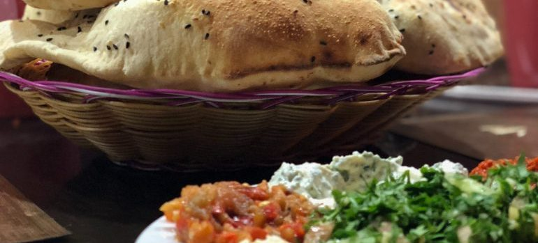 Pita bread and traditional Middle Eastern mezah in a restaurant in Riyadh