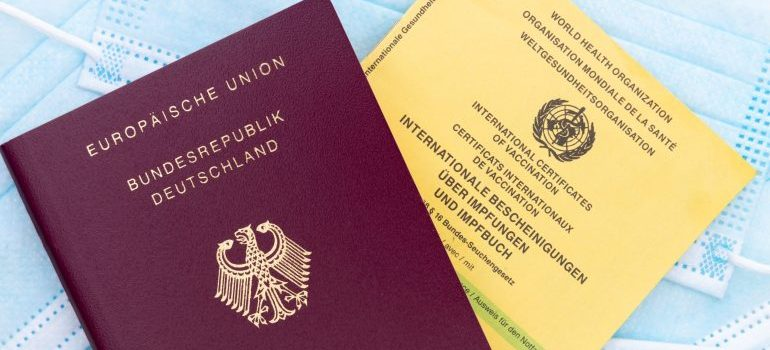 A passport and a Vaccination card