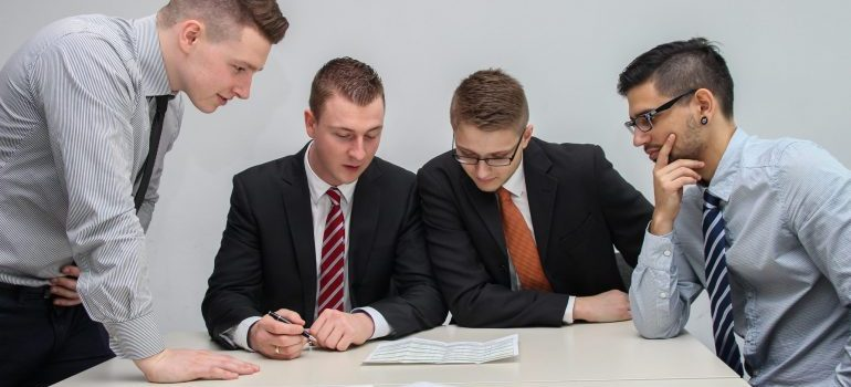 4 man reviewing a document