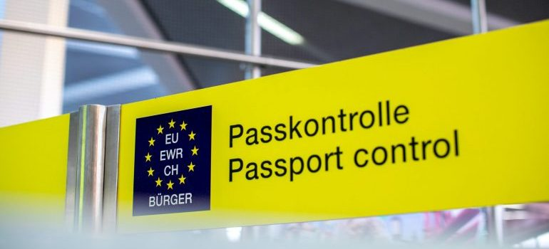 Passport control sign - migration changes in 2021