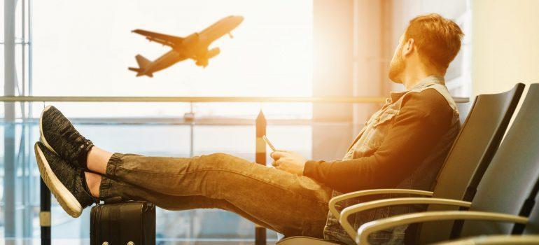 A man sitting at an airport terminal
