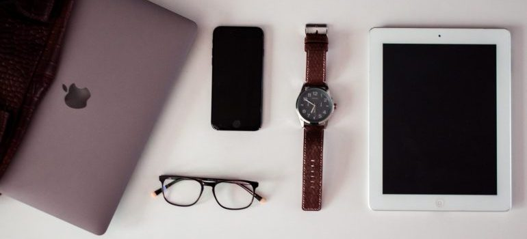 laptop, spectacles, a watch, phone and tablet